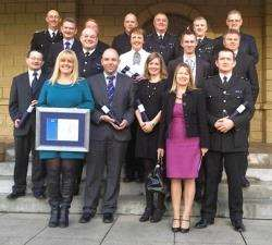 PC Joanna Copsey (second left) receives the awards on behalf of Angie and herself