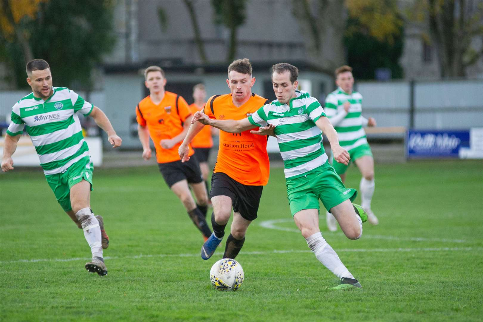 Rothes' Ali Sutherland and Buckie Thistle's Kevin Fraser compete for the ball. Picture: Daniel Forsyth..