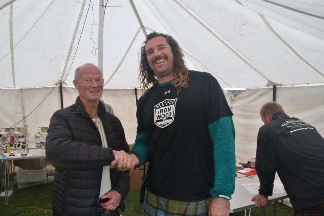 New world record holder Colin Dunbar of California with Assynt Games chieftain Duncan Hutchison. Picture: George Olivier