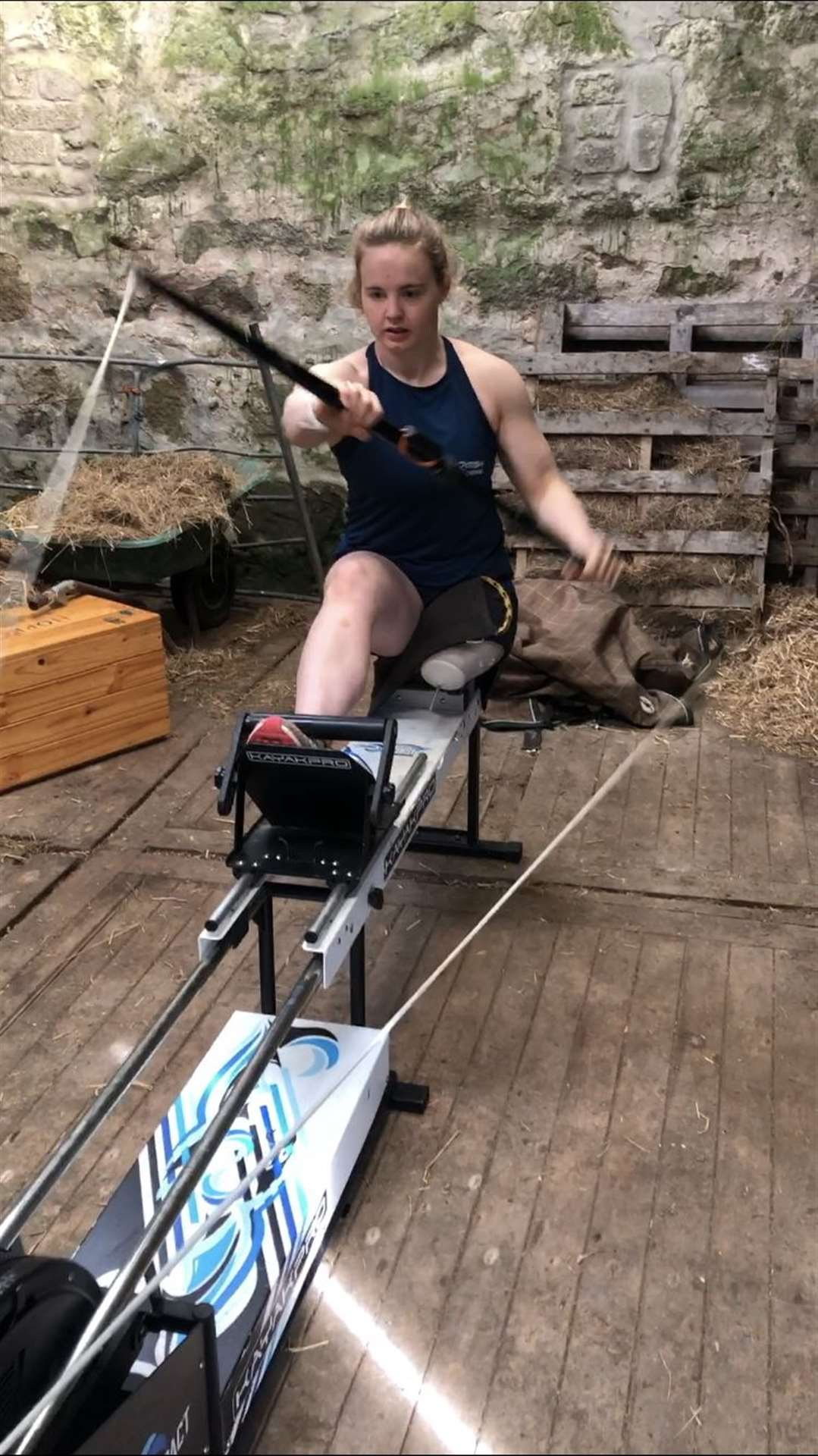 Hope Gordon training on her kayaking machine in the barn which has been converted into a gym.